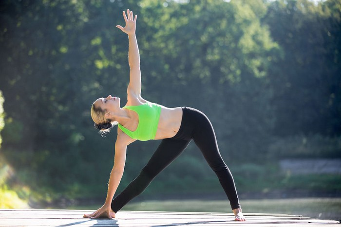 yoga poses for back-pain relief in women , triangle pose